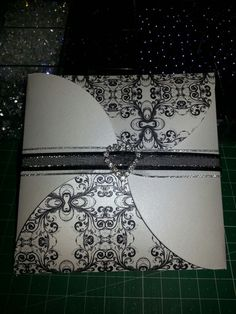 Black, White and Silver wedding invitation.  The ptinying was done in a rsised print.
