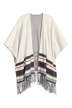 H&M+ Fine-knit poncho: Poncho in a soft fine knit containing some alpaca wool with wide armholes and a fringed hem.