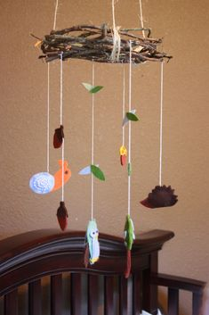 woodland nursery mobile - cute idea to use grapevine wreath as the mobile top