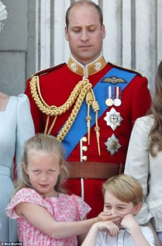 Unamused: The Duke of Cambridge gives Savannah and Prince George a disapproving look