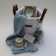 Introducing our new Ice Angles Basket.  A beautiful blue scarf paired with an Amanda Jane Candle, a cute bottle of white matches. A set of stunning blue earrings and shell ring dish and finished of with a handmade angel keyring with feathers. The gift can either be packaged in our new stone eco-friendly proudly South African basket with leather handles. The perfect  Keepsake! Or in one of our classical gift boxes, tied with a satin ribbon
