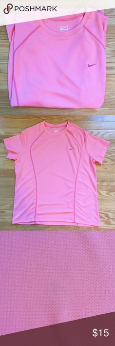 Nike Performance Wear T-Shirt High Quality Nike Performance Workout Wear in Salmon Pink. Slight discoloration (see pic 3) not noticeable. In EUC. Nike Tops Tees - Short Sleeve