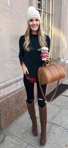 #winter #outfits white knit cap, black crew-neck sweater, brown leather boots and brown leather 2-way handbag