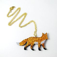 These beautiful foxes would look great with any outfit - theyre sweet enough to be worn every day, but sparkly enough to jazz up a LBD for an evening soiree.  Each little fox measures 5cm long and just less than 3cm tall.  The foxes are made from wood which is painted and then carefully foiled before being treated with varnish for durability. You can choose which colour fox youd like from the menu on the right.  The pendant hangs from an 18 trace chain in your choice of silver-plated or…