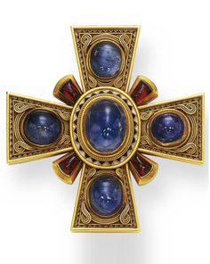 AN ANTIQUE SAPPHIRE, GARNET AND GOLD MALTESE CROSS BROOCH. Centring upon an oval cabochon sapphire, within a white and blue enamel frame, accented by gold wirework, each similarly-set arm alternating with cabochon garnets, the reverse enhanced by decorative engraving, mounted in gold, circa 1870. #antique #Victorian #brooch