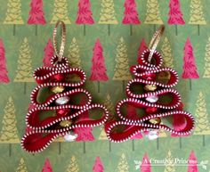 A Creative Princess: Zipper Christmas Ornament - ... take apart a  22 inch zipper. Then all you do is wind your zipper in loops and hot glue a bead in between. I added a bead to the bottom for the trunk and made a loop with the zipper at the top.Add a ribbon through the loop to hang.