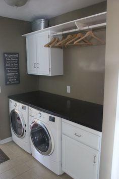 Contemporary Laundry Room with limestone tile floors, Built-in bookshelf, flush light