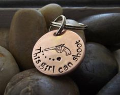 This girl can Shoot copper Key chain