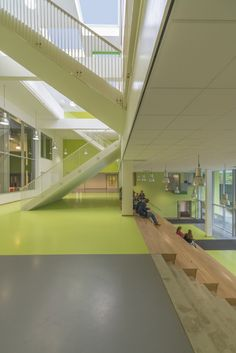 Amstelveen College / DMV architects, entry, commons forum seating, skylights, atrium stair, green rubber floor