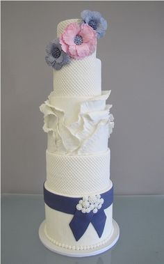 Unique wedding cake love the colors :) grey soft pink white and navy blue together