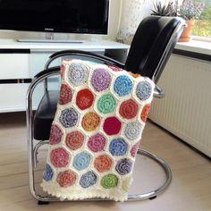 My crochet hexagon woolen blanket on my gispen chair #crochet #hexagon #multicolor #afghan #blanket #gispenchair #gehaakte #veelkleurige #hexagon #deken #stoel #crochetafghan #crochetblanket #crochethexagons