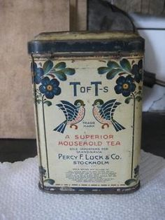 vintage tea tin marked 'T of T's A Superior Household Tea, Percy F. Luck & Co., Stockholm' and decorated with bird and flower motifs, c.1900-1950?
