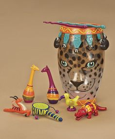Battat Jungle Drum Music Set. Little ones can march to the beat of their own drum, or whatever instrument suits their taste, with this sweet set of musical toys that all fit into a compact case. Includes snake drumsticks, tambourine, slide whistle, hand drum, water whistle & two maracas $39.99