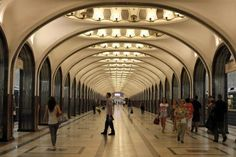 People wait for the train in Mayakovskaya metro station, which was built in 1938, in Moscow, August 17, 2013.