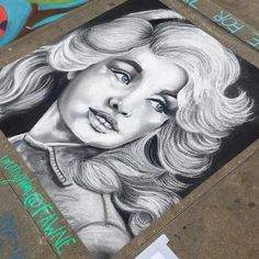 Amazing rendering of @dollyparton by @fawne! @dogwoodarts #gachalkartists #chalkwalk #sidewalkchalkart #chalkart