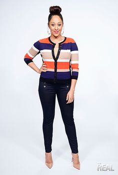 Tamera is rocking a Karen Millen sweater and pants with Christian Louboutin pumps.