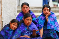 In Zinacantan (State of Chiapas), Mexico, girls attired in deep blue and purple outfits sit on the steps.    From NatGeo's A World Apart.
