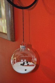 """melted snowman ornament. Salt. Peppercorns. Fimo clay """"carrot."""""""