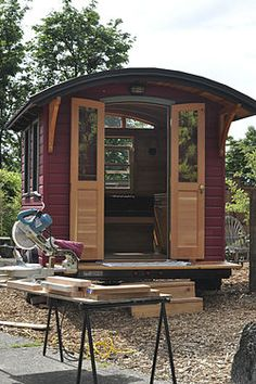 small mobile house on display in portland oregon during an alternative dwelling building workshop
