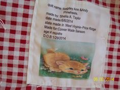 #6 showing the back of Raggedy Ann & Andy :baby quilt for Conner Wade  this is a pic. Of the label I made.