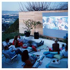 Planning an Oudoor End-of-Summer Movie Party: You can rent a large, outdoor movie screen from companies like Funflicks or Moonlight Flix, provide comfortable seating, & set up a popcorn station, with a variety of topping flavors.