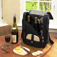can be a three bottle carrier with glasses removed - but what I like about these picnic bags is that there is a place for the wine opener and a small cutting board too for a snack. Picnic At Ascot London Pinot Wine and Cheese Cooler & Reviews | Wayfair