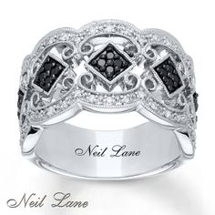 The glamour of vintage Hollywood is the inspiration of this dramatic ring for her from the Neil Lane Designs® collection. Squares decorated in round black diamonds are surrounded by round white diamonds set into lustrous curves of sterling silver. Milgrain detailing completes the look. Neil Lane's signature graces the inside of the band. The ring has a total diamond weight of 1/3 carat. Black diamonds are treated to permanently create the intense black color. Diamond Total C...
