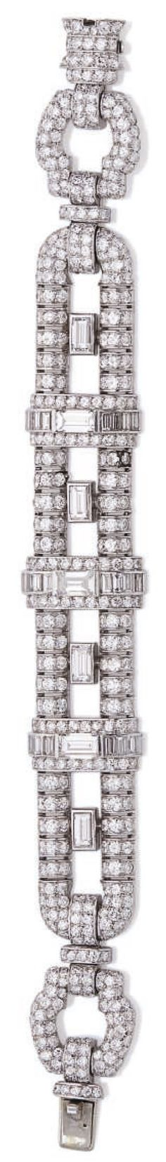 AN ART DECO DIAMOND AND PLATINUM BRACELET , CIRCA 1930. The fully articulated bracelet consisting of geometric openwork links pavé set with round and baguette diamonds, mounted in platinum.