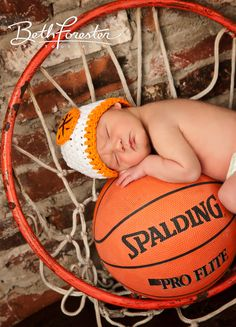 Newborn photo with basketball and basketball rim by WV NB photographer Beth Forester