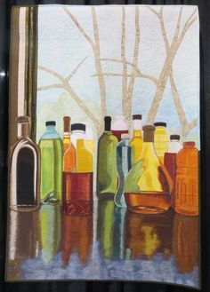 """""""Turning Bottles into Stained Glass"""" by Sara Sharp. Still life, art quilt, thread painting.  Photo by Cathy Geier's Quilty Art Blog: 2015 International Quilt Festival, Chicago."""
