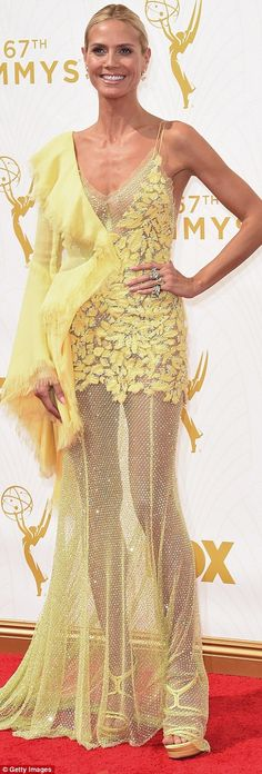 Call her mellow yellow: Heidi Klum made a grand entrance in her canary dress that was see-through on the bottom and had matching platform heels