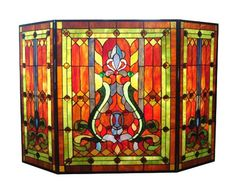 Stained glass home decor is elegant, trendy and timeless.  As evidence of this just look around you.  Many beautiful homes use a combination of stained glass wall decor, stained glass wall hangings and stained glass accent lights to create a vibe that is the epitome of beautiful, relaxing and inviting.    River of Goods 8221 Stained Glass Fireplace Screen