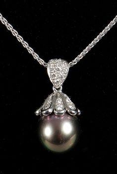 11mm Mikimoto tahitian pearl set in platinum with diamonds