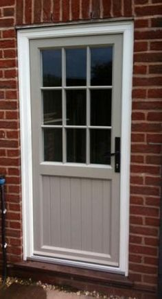 We offer a beautiful range of uPVC doors with a timber finish in Colchester, Chelmsford and Essex. Contact us today for more information or visit us for your faux wooden doors. Cottage Front Doors, Porch Doors, Cottage Door, Front Door Entrance, Front Door Colors, Windows And Doors, Upvc Windows, Laundry Doors, Garden Doors