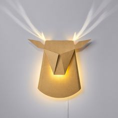 Self-Assemble Cardboard Deer Head LED Light Fixture by Popup Lighting. The deer head is a self-assembly folded cardboard decorative lamp. It is 39cm long x 35.5cm when switched off. When lights are on it becomes 75cm x 70cm of light and brilliancy. Color- natural cardboard. Mounting- Wall pendant Lamp (Bulb) Description- 3*4 LED module 2700k 120lm- 2.1w Environment- Indoor Operation- cable switch Weight- 2.8 Ibs (1.3 kg) Voltage (V)- 110- 230 Electricity installation - Electricity Plug…