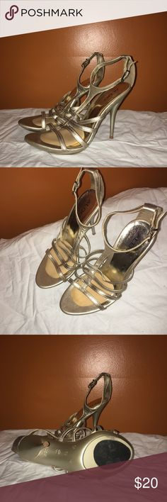 Aldo gold heels Worn a few times, but I'm good condition. There is a non slip grip on the bottom and the slip grip on the inside of the shoe. Both can be taken off. Aldo Shoes Heels