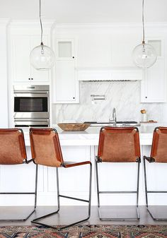 Kitchen Interior Design This white kitchen could be so sterile if it weren't for the leather bar stools, natural wood accents and accent runner. Vintage Kitchen Decor, Home Decor Kitchen, New Kitchen, Kitchen Interior, Home Kitchens, Kitchen Dining, Kitchen Island, Island Bar, Kitchen Stools