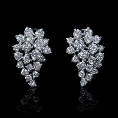 NEW: Diamond cluster earrings featuring 40 round brilliant cut white diamonds 2.31ctw set in 18k white gold. #jewelry #love #bridal