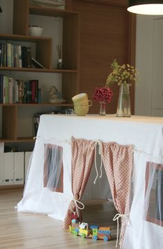 Playhouse tablecloth for children. Easy to set up - it takes just a few seconds and a table reverts to a little house. Indoor and outdoor