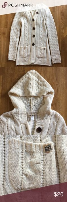 White knit jacket Long white knit Billabong jacket with large brown buttons. It hits about mid thigh. Super cute and perfect for a cool night! Billabong Jackets & Coats