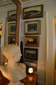 (via n e u t r a l s / beautiful art hung close to antique mirror very nice)