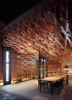 In Dazaifu, Japan, there's a starbucks coffee shop designed by Kengo Kuma and Associates which has a very interesting interior. Over 2000 woooden sticks line the walls and ceiling of the shop, making this place stand out. Diagonal weaving was used for this project to create fluidity throughout.