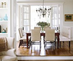 I love how the dining room is up a step!  The different levels create interest!  The french doors are also amazing.