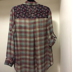 Plaid & floral convertible sleeve top Xhiliration convertible sleeve high low shirt. Button down with collar and two front pockets. Sheer with plaid and floral print. 100% polyester. Worn only once. Great condition! Perfect with leggings! Xhilaration Tops Button Down Shirts