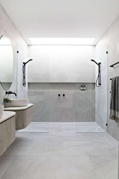 If there's one thing that absolutely takes your bathroom to next level, it's large format tiles. They give your bathroom the look of uncomplicated sophistication. And you know what they say about big tiles 💁🏼‍♀️🙊 .less grout lines to clean 😉 Bathroom Renos, Laundry In Bathroom, Bathroom Renovations, Large Tile Bathroom, Rain Shower Bathroom, Shower Over Bath, Double Shower, Bathroom Grey, Master Shower