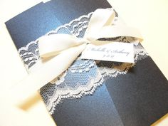 I like the lace and ribbon for the belly band. Unfortunately lace is sooo expensive, still a pretty invite. http://www.etsy.com/listing/68405846/lace-wrapped-wedding-reception