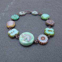 Elephant beaded bracelet, ceramic bead, artisan beaded jewelry by BeadyDaze on Etsy https://www.etsy.com/listing/216969223/elephant-beaded-bracelet-ceramic-bead