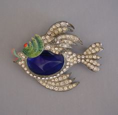 Staret iconic fish brooch with a colorful enameled face from MorningGloryJewelry.com : Buy online now for $398.00