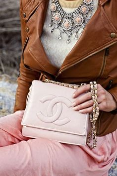 Brown Leather Jacket With Necklace and Chanel Handbag