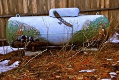 Propane and water tanks, exteriors, painted with murals or faux finishes for camoflauge and tank art by Darwin Designs in California Propane Tank Art, Propane Tank Cover, Murals Street Art, 3d Street Art, Farm Art, Outdoor Projects, Pallet Projects, House With Porch, Garden Art